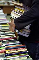 Book buyer with an armload of books