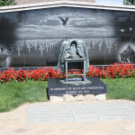 Peacoat Memorial in memory of military personnel buried at sea; North Wall in background