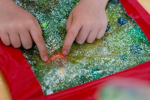 Child exploring sensory bag.