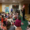 Ms. Linda and a room full of families celebrate the birthday of Dr. Seuss.
