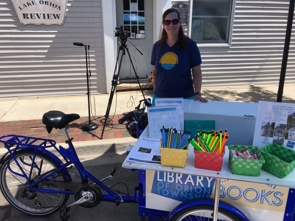 Youth Librarian Suzanne with the Bookbike at Dragon on the Lake