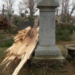 "Snapped tree laying near ""Tunison"" headstone in Evergreen Cemetery"