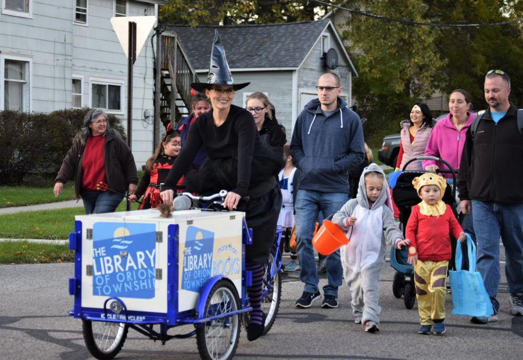 Bookbike and families walking in the LO Halloween parade
