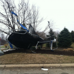 Mangled trampoline at the entrance to Heather Lakes Estates in Independence Township.