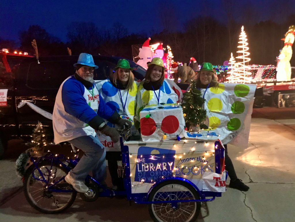 Bookbike decorated for the holiday parade with staff and volunteers.