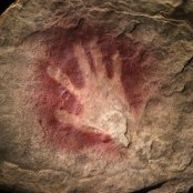 human handprint outline on rock