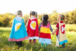 Kids in superhero capes