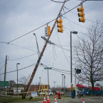 Damaged pole and lines in front of Kroger at the corner of M24 and Elizabeth