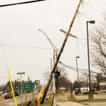 Snapped telephone pole on M24 in front of Kroger, Lake Orion.