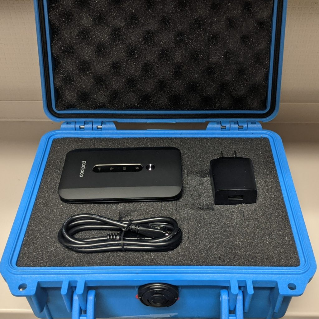 Coolpad Hotspot, charging adapter, and USB cable in padded blue Pelican hardcase