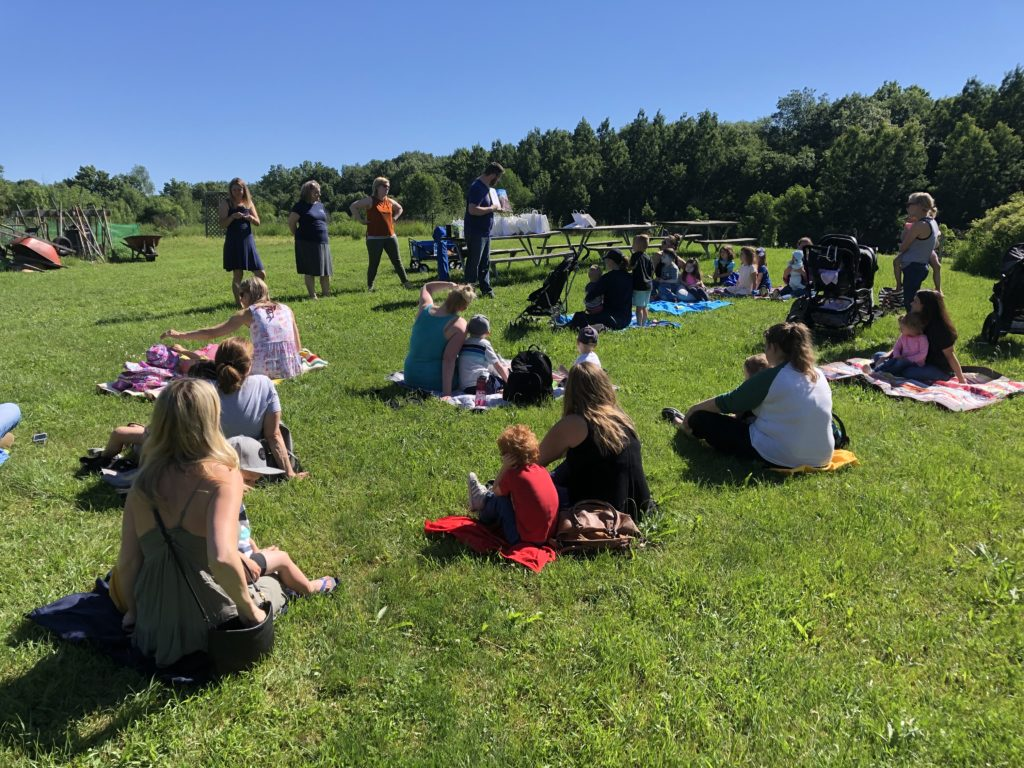 Families gathered at a local park for storytime.