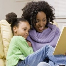 Young girl and mother reading