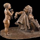 statue of early man and child