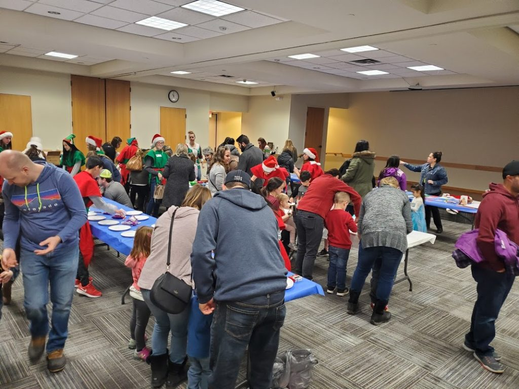 Families working on Christmas crafts.
